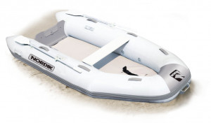 Brand new Nordik 290 Airdeck inflatable boat with welded seams reduced from $2499 to $2199 with a free boat cover!